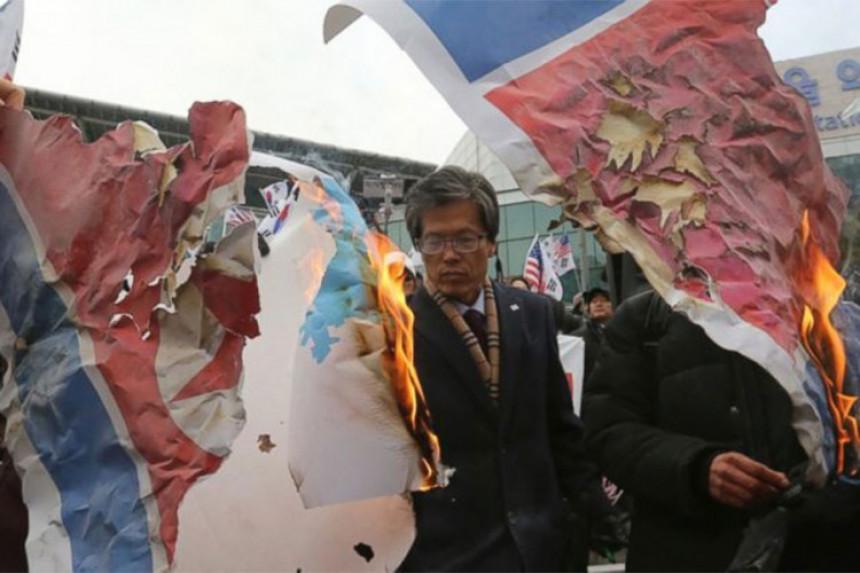 Spalili sliku Kim Džong Una