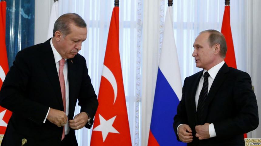 Kurdi pale slike Erdogana i Putina